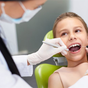 A young child at her dental exam.
