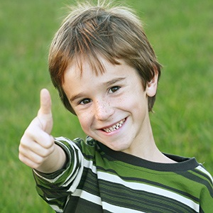 Young boy giving excited thumbs up