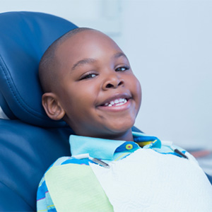 Young boy smiling in dental chair