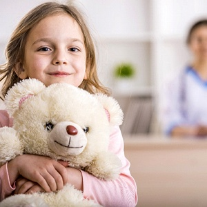 girl smiling teddy bear
