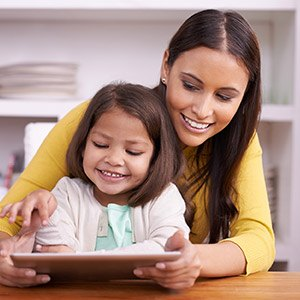 Naperville Preventive Dentistry Mother and Daughter using tablet