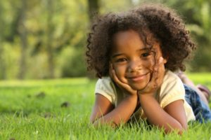 little girl curly hair smiling