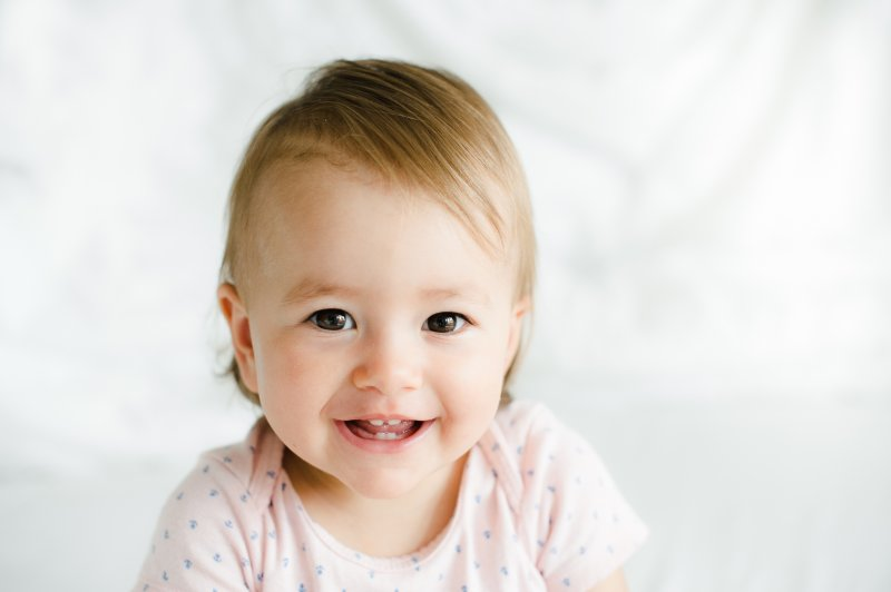 Closeup of toddler smiling with baby teeth