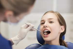 Teenager visiting her dentist for teens in Naperville